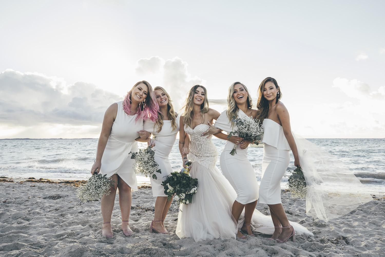 Brides and bridesmaids having some fun