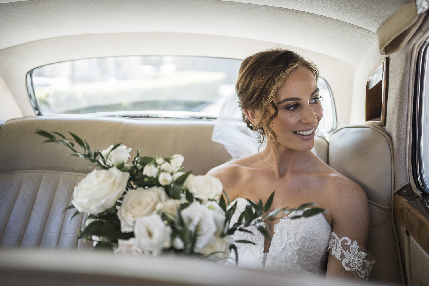Bride in the limo before the church ceremony at Mercedes college